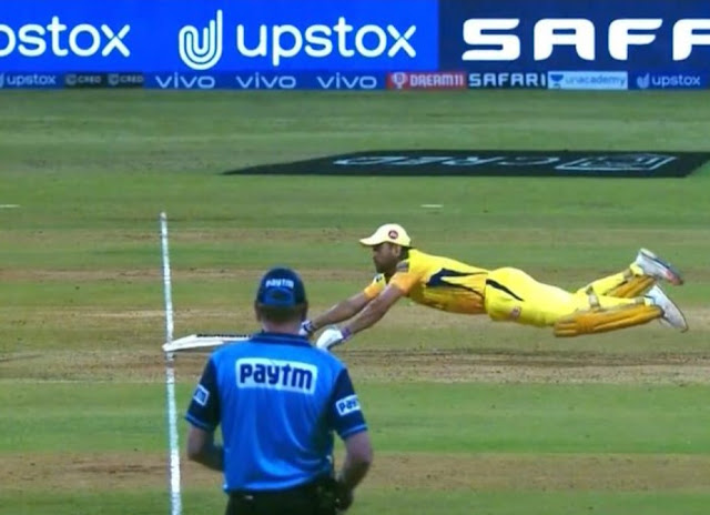 MS Dhoni puts a full-stretched dive
