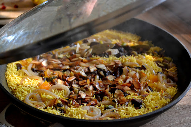 Persian jeweled rice steaming in a pan