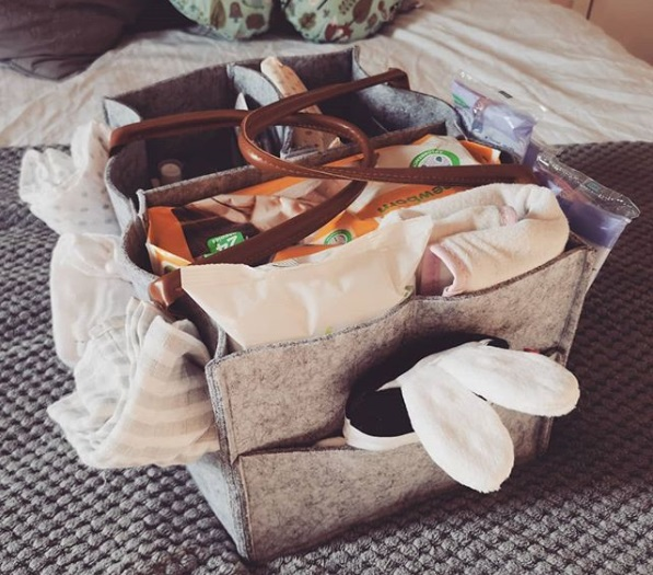 A picture of an organised baby essentials box for breastfeeding, formula feeding and nappy changes.