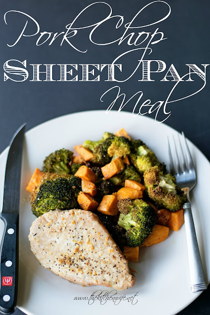 The pork chop and roasted vegetables on a plate with silverware and the title above.