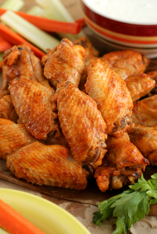 This Crock Pot Chicken Wings recipe is the best way to get bold, spicy, fall-off-the-bone wings.  You will never believe that they are cooked in the crock pot with just three ingredients!