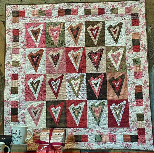 Tickled Pink Quilt Free Pattern designed by Janet Rae Nesbitt of One Sister Designs