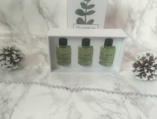 travel sized mini bottles of Olverum bath oils