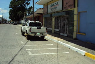 White lines indicate paid parking in La Ceiba, Honduras