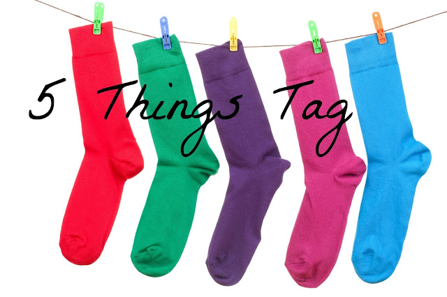 """5 Things Tag"" text on background of 5 differently coloured socks on a washing line"