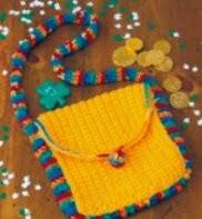 http://translate.googleusercontent.com/translate_c?depth=1&hl=es&rurl=translate.google.es&sl=en&tl=es&u=http://www.countrywomanmagazine.com/project/rainbow-crocheted-purse/&usg=ALkJrhh69tdAGv9FgiU0xyefJuZk1pqwcw