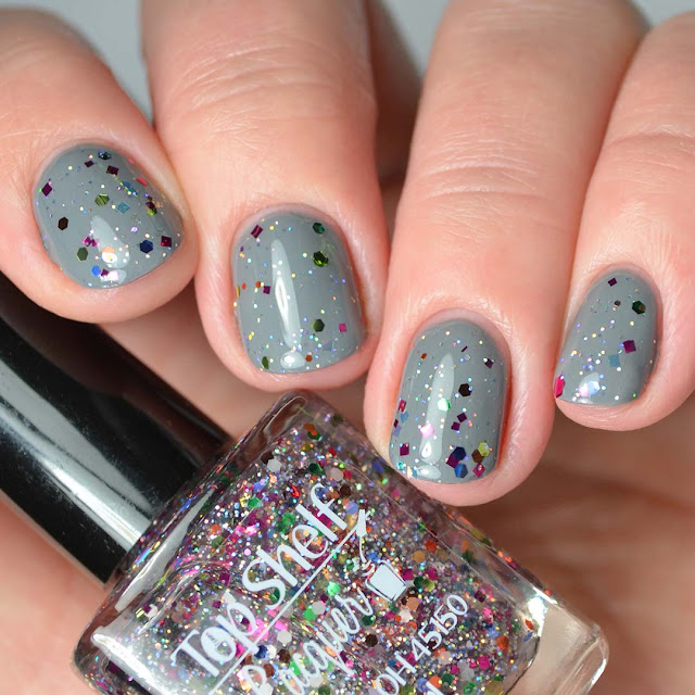 rainbow glitter nail polish four finger swatch