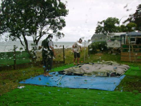 Erecting the tent in a windstorm is no picnic
