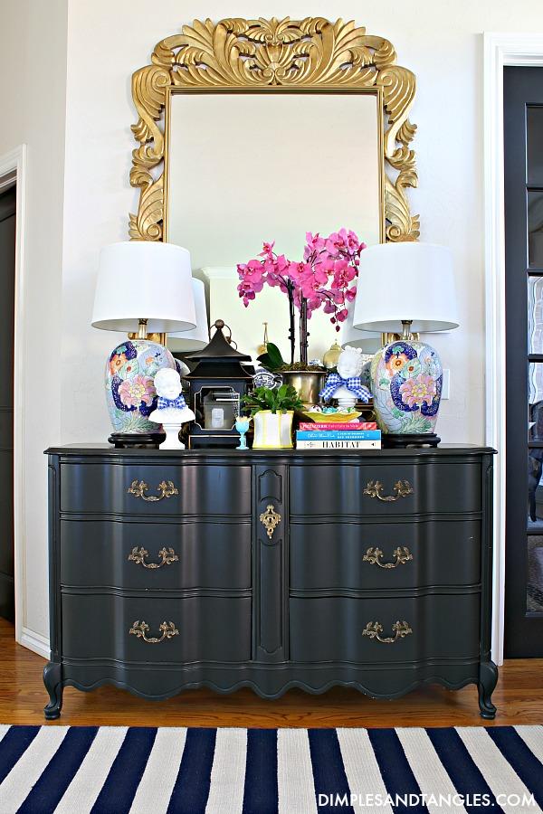 large gold mirror, french provincial dresser, striped rug, tobacco leaf lamp