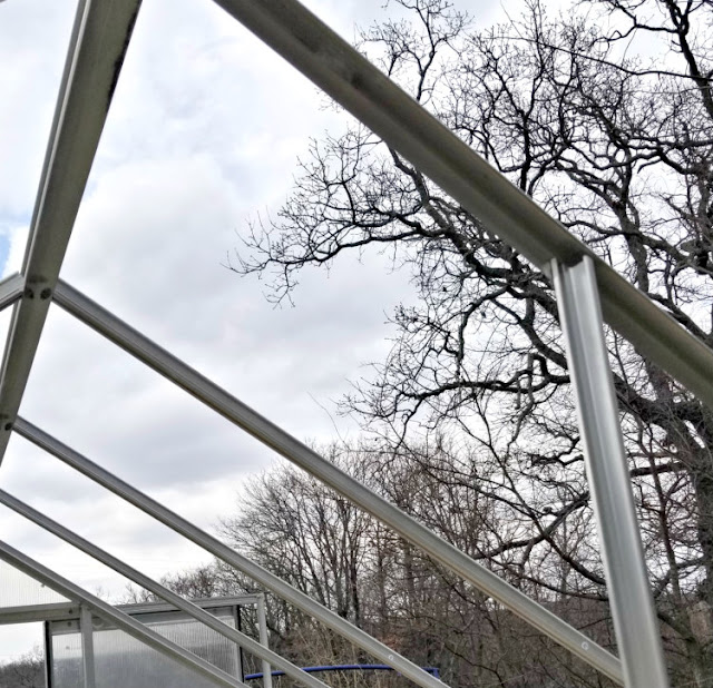 The roof structure of the small greenhouse is made of aluminum.