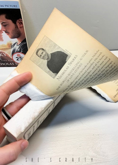 How to make a DIY decorative book stack |  how to tear the cover off of a paperback book