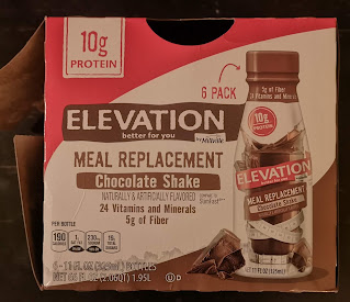 A rather poorly lit open box of Elevation by Millville Chocolate Meal Replacement Shakes, from Aldi