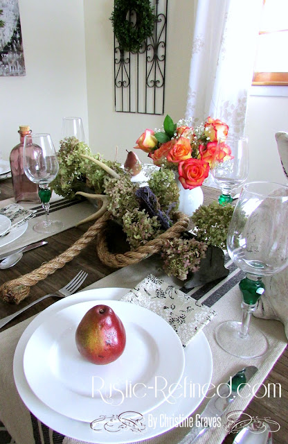 Tablescape for the spring season mixing antiques and white dishes