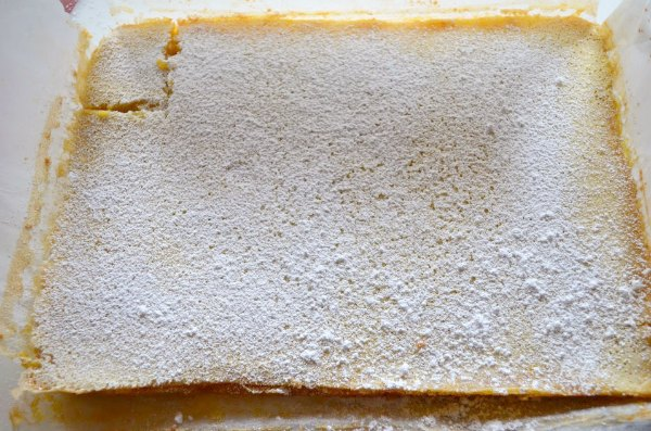 Lemon Bars recipe dusted with powdered sugar.