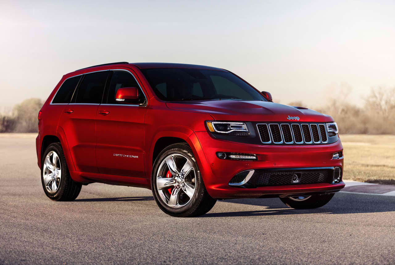 Inside, The Grand Cherokee Receives Some Updates Including A New Steering  Wheel With Standard Paddle Shifters, A 7 Inch Configurable Screen In The  Gauge ...
