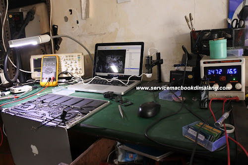 service macbook pro retina not charging di malang