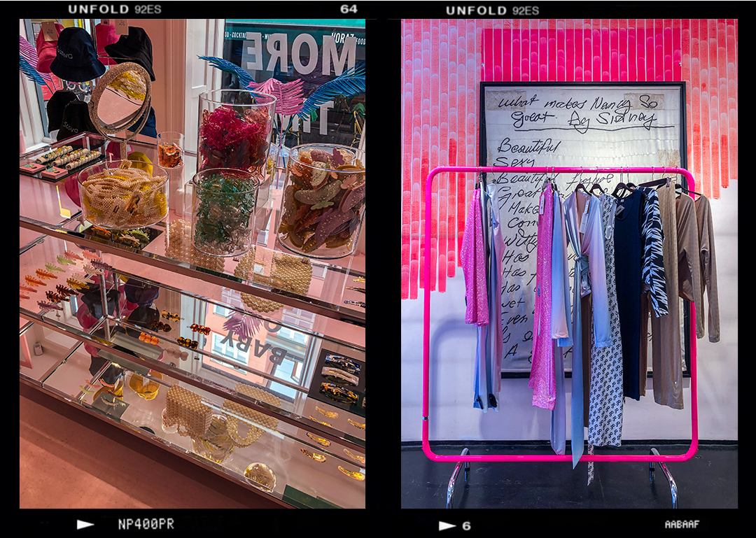 shopping in Copenhagen on a budget; hair accessories display in store, rack of clothes against pink decorative wall in mags norgaard