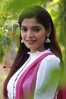 Sanchita Shetty Latest Photos in White Skirt and Bloue at Ennodu Vilayadu Press Meet