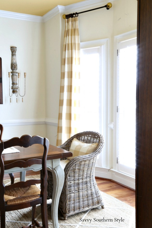 wicker/kubu chairs as host and hostess chairs in a French country dining room