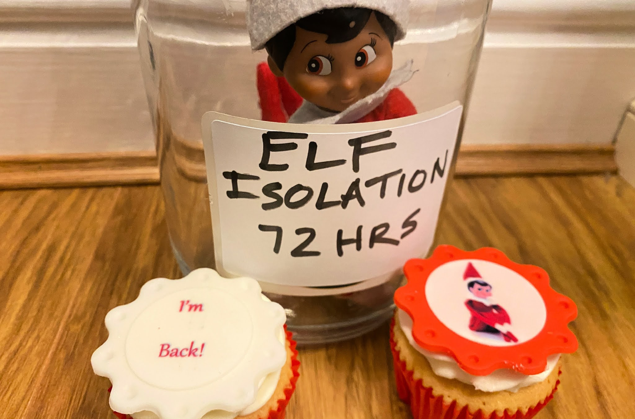 elf on the shelf in a glass jar