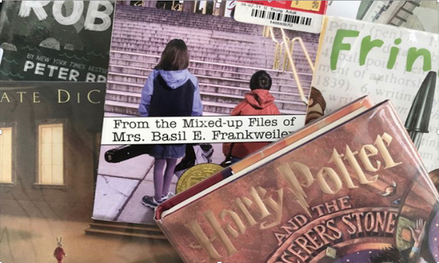 A pile of read aloud novels on the fourth grade level