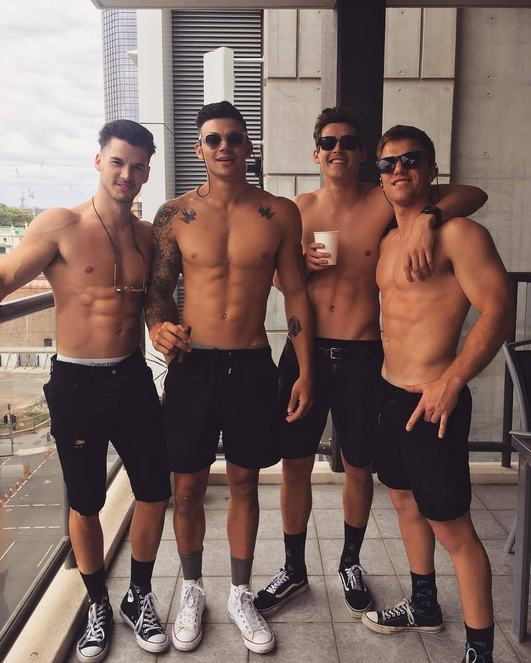 fit-four-shirtless-male-models-sunglasses-gay-friends-posing-apartment-party