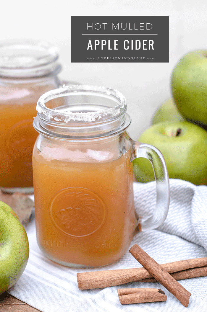 Clear mug of hot mulled apple cider