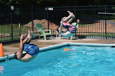 Picture of swimmers doing flips into the pool. Why not bombs or flips?
