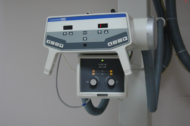 double and triple center rotation x-ray machine