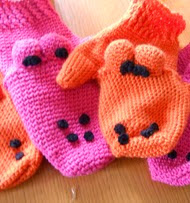 http://www.ravelry.com/patterns/library/dino-mittens