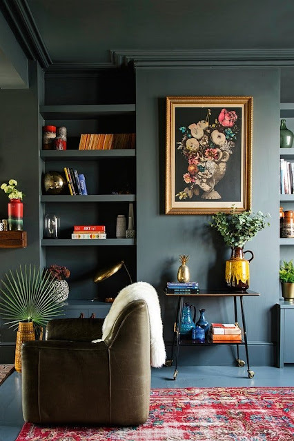 Dark green walls in beautiful living room on Hello Lovely
