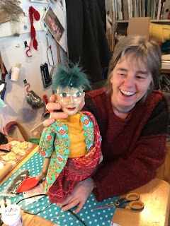 Corina Duyn with puppet by her student- with green mohican hair style