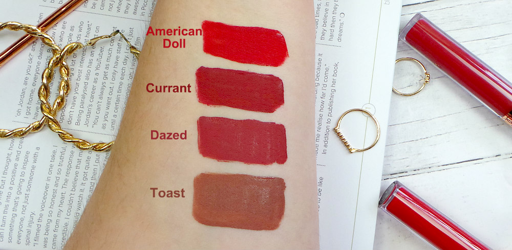 Image shows an arm with lipstick swatches on it. Top-Bottom American Doll a classic red, Currant a brick red, dazed a redwood and toast a muted rosewood.