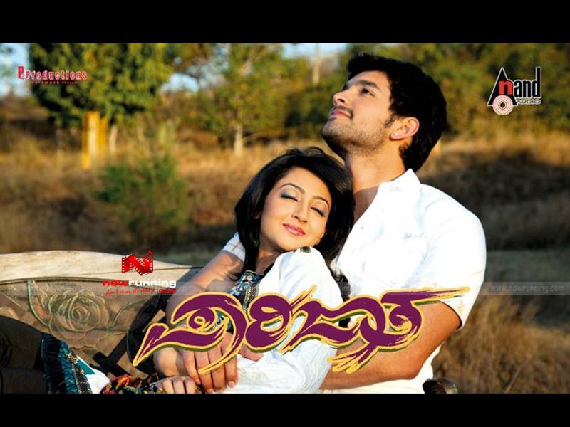 Rachita Ram and Darshan in Kannada Movie Ambareesha - Kempe