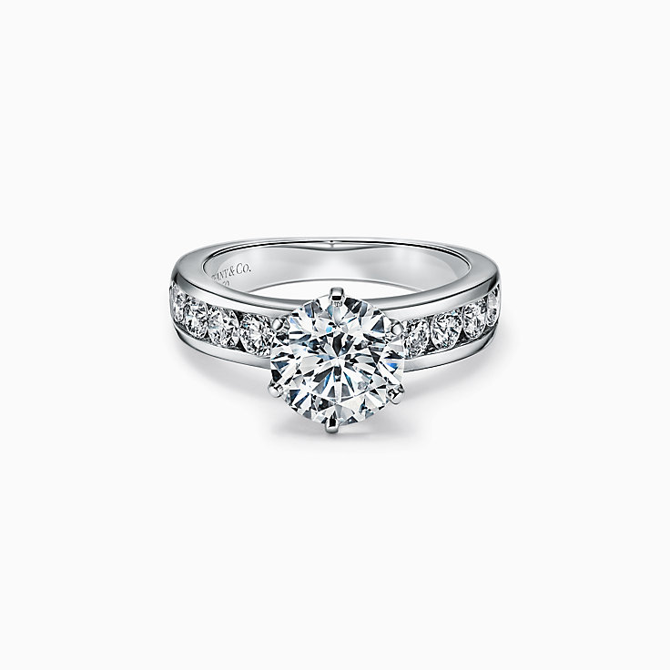 The Tiffany® Setting Engagement Ring with a Channel-set Diamond Band in Platinum