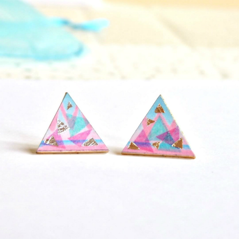 pair of triangular paper earrings in pink, blues, white with foil accents
