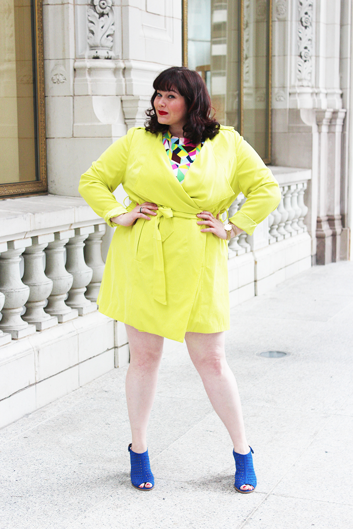 Plus Size Blogger Amber from Style Plus Curves in a Simply Be USA Colorful Abstract Dress, Bright Yellow Coat and Blue Accessories