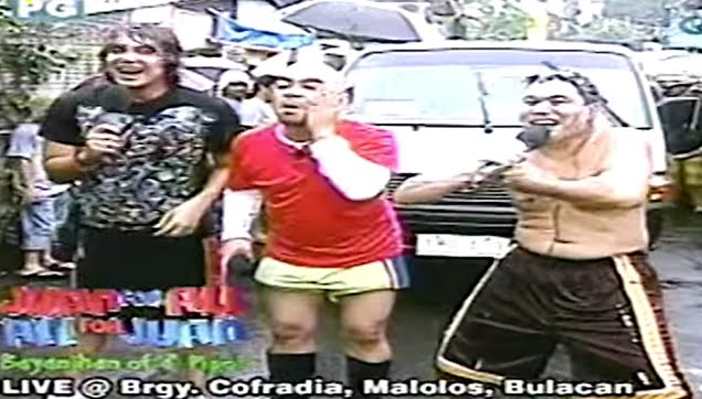 Jose, Wally and Paolo in Juan for all, all for Juan under the rain
