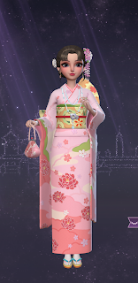 Yuko in a traditional pink kimono with beaded floral decorations hanging from her hair