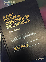 A First Course in Continuum Mechanics, by Y. C. Fung, superimposed on Intermediate Physics for Medicine and Biology.