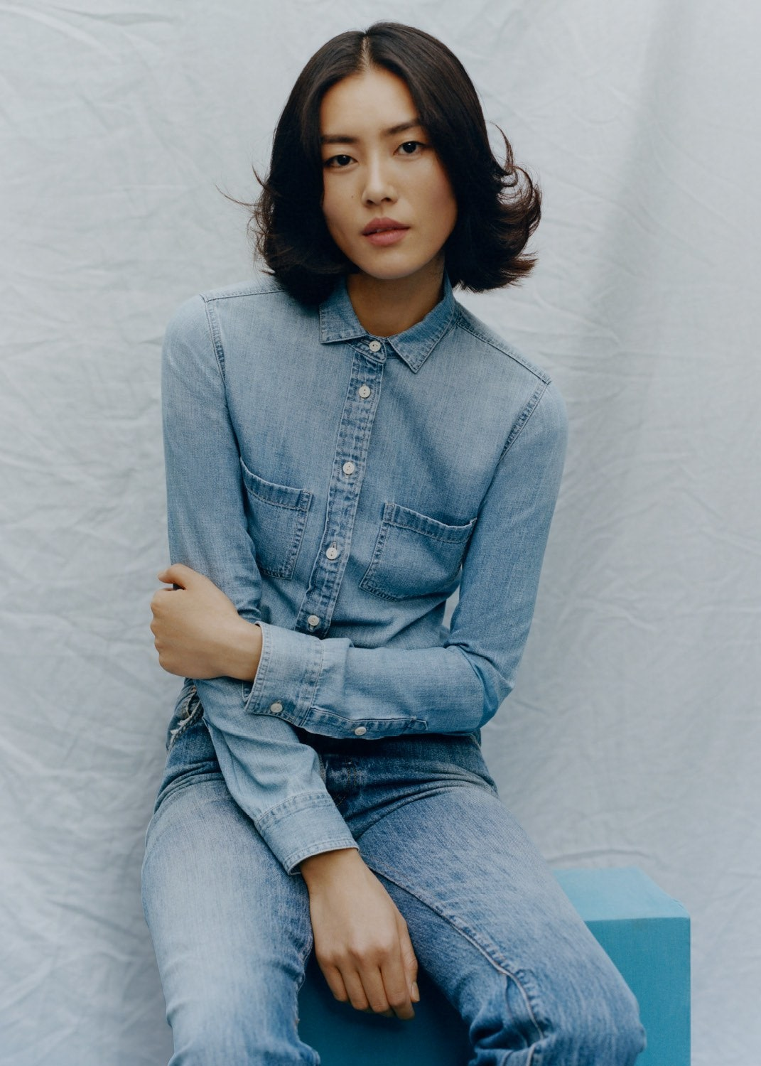 Liu Wen - J. Crew shirt. AG jeans. Photographed by Tyler Mitchell, Vogue, April 2020