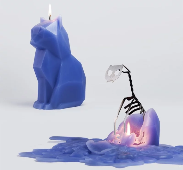 a purple candle in the shape of a cat