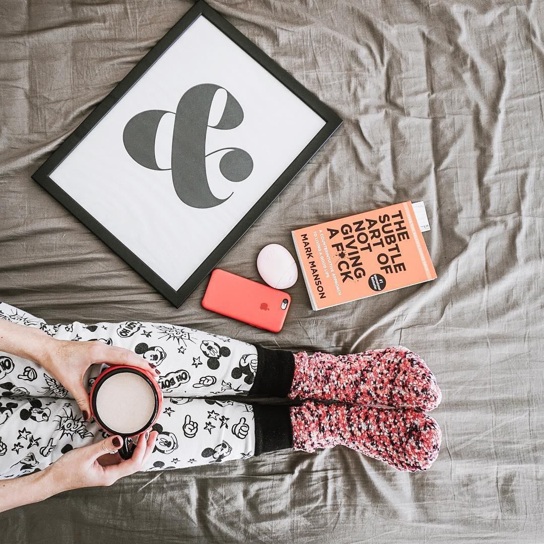 flatlay, lifestyle blog, travel blog, home, cozy home, cozy coffee, the subtle art of not giving a fuck, mickey mouse pants, wall art