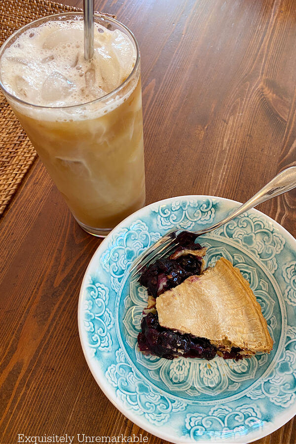 Summer Blueberry Pie and iced coffee on the table