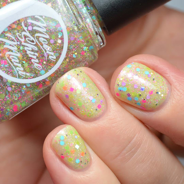 neon glitter nail polish topper swatched over yellow