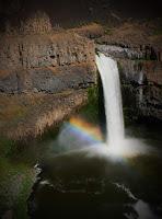 rainbow at the bottom of palouse falls, washington