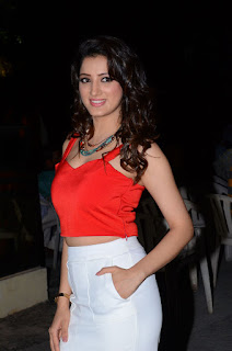 Richa Panai in Red crop top and white leg split skirt at eedu gold ehe movie event