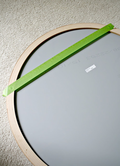 painter's tape hanging art trick