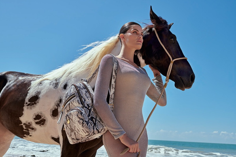 Posing with a horse, Isabeli Fontana fronts Luz da Lua summer 2020 campaign