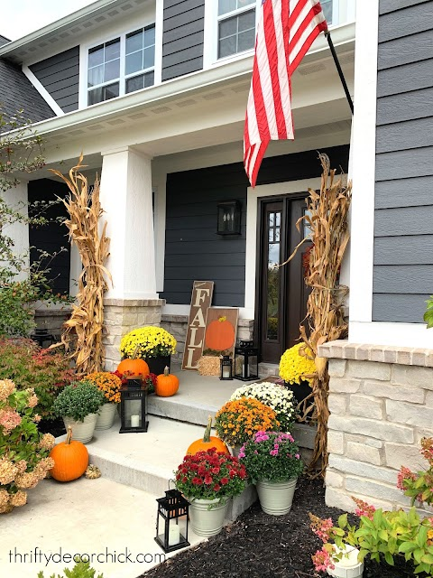 Fall front porch with mums and corn stalks